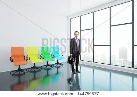 Businessman with briefcase and colorful swivel chairs in interior with glossy concrete floor and panoramic window with city view. Side view 3D Rendering