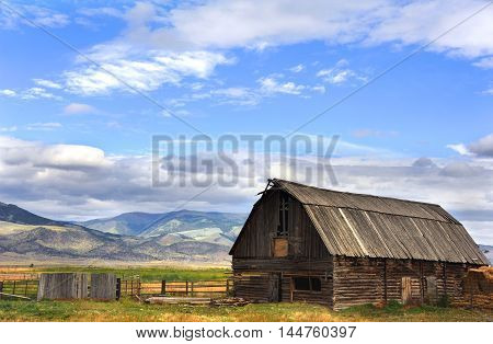 Pole barn sits with view of Gallatin Mountains in Happy Valley Wyoming.