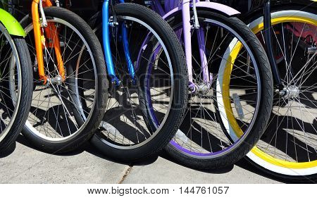 Background image shows a group of colorful bicycles. Bikes are for rent in Bozeman Montana.