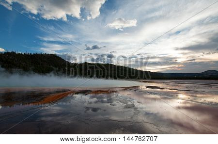 The Grand Prismatic Hot Spring at sunset in the Midway Geyser Basin along the Firehole River in Yellowstone National Park in Wyoming America