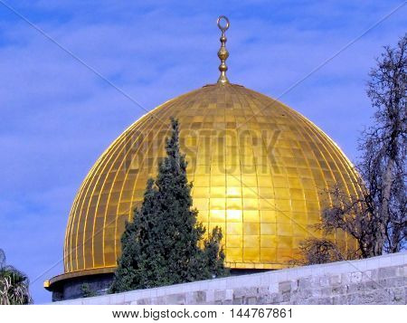 Gold Dome of Rock Mosque against a blue sky in the old city of Jerusalem Israel
