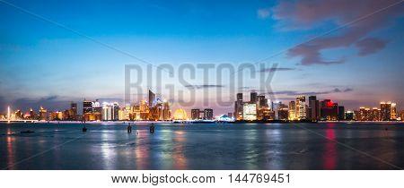 illuminated hangzhou qianjiang new city from water
