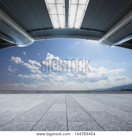 landscape of hill and sky from empty brick floor