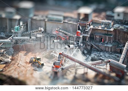 Mining truck working in quarry tilt-shift effected photo.