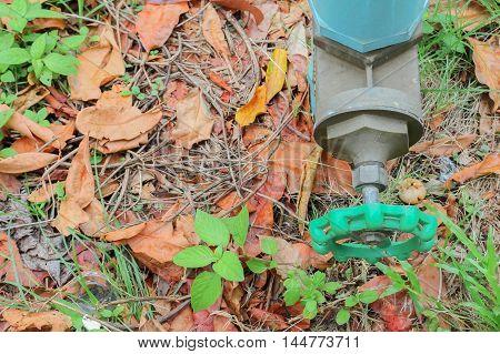 water valve plumbing steel  industrial tap pipe on grass