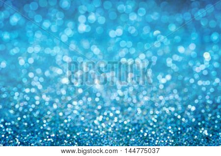 The abstract background blue bokeh circles as background.