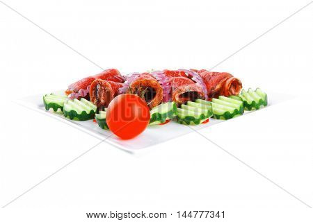 fresh red barbecue meat bacon served on plate with vegetables isolated on white background
