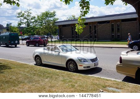 PETOSKEY, MICHIGAN / UNITED STATES - AUGUST 5, 2016: A white Lexus convertible sports car is parked near downtown Petoskey
