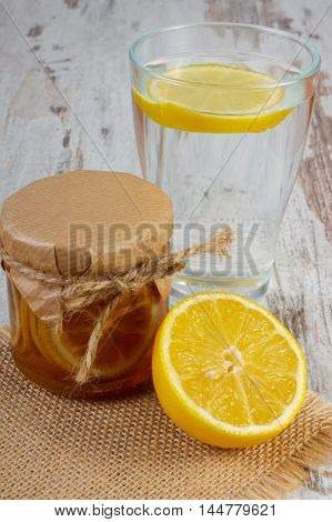 Fresh Lemon With Honey And Glass Of Water With Slice Of Lemon