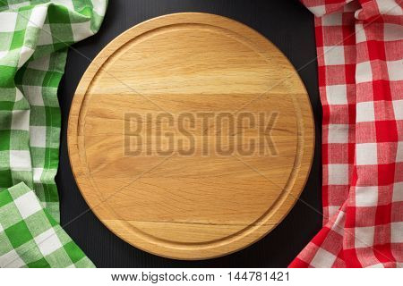cutting board at wooden table surface