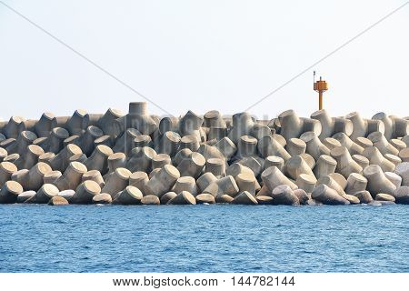 Concrete tetrapods make up a breakwater in Jeju Island South Korea.