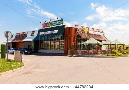TVER REGION, RUSSIA - JUNE 26 2016: McDonald's fast food restaurant at the highway Moskva - St. Petersburg. McDonald's is the world's largest chain of fast food restaurants