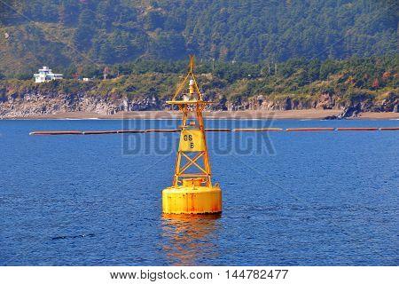 yellow sea buoy in blue sea of Jeju, South Korea