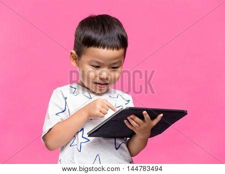 Little kid using dgital tablet