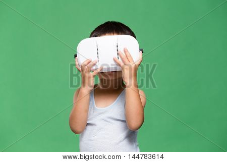Little kid watching though VR device