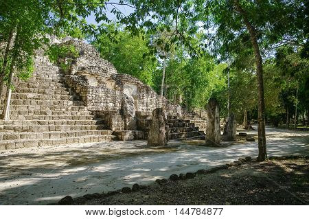Steps of the pyramid stairs. Structure of 1 in the complex rises over the jungle of Calakmul Mexico