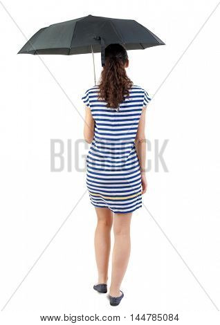 young woman in dress walking under an umbrella. Swarthy girl in a checkered dress holds an umbrella over his head.