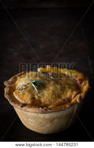 Rustic Steak and Cheese Pie on Baking Tray Dark Background Copy Space Vertical
