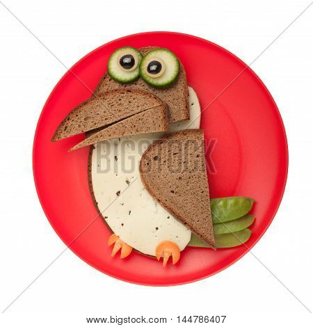 Surprised crow made of bread and cheese on plate