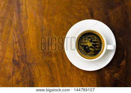 coffee cup on wooden table soft focus