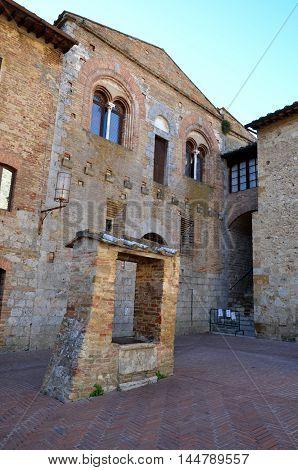 Small square in San Gimignano, Italy, Tuscany. Unesco site