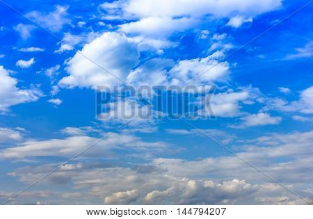 sky background blue with white clouds .