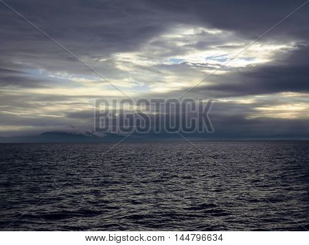 Kamchatka view with misty mountains and the Pacific Ocean