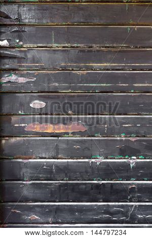 Old steel rolling shutter background. Grungy and rotten tone color.