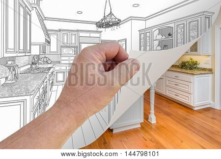 Male Hand Turning Page of Custom Kitchen Drawing to Finished Photograph Underneath. The property release attached is the same PR that has been accepted for hundreds of the same photos in my portfolio.
