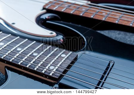 electric guitar and bass guitar on a gray background