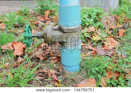 Water valve Plumbing Steel on grass. industrial tap  pipe. :Close-up, Select focus   with shallow depth of field :