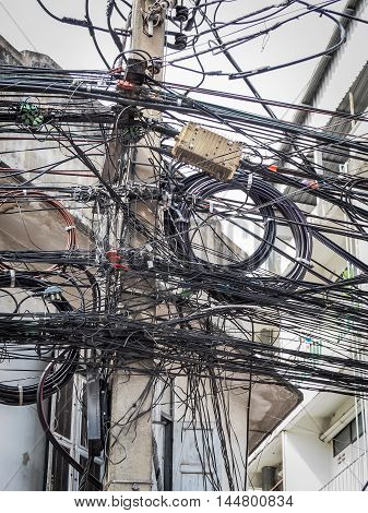BANGKOK: August 23: The chaos of cables and wires on  every street on August 23, 2016 in Bangkok, Thailand.