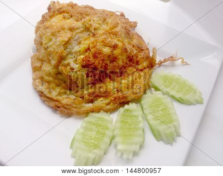 Omelette On The White Dish, It's Popular Traditional Thai Style Food.
