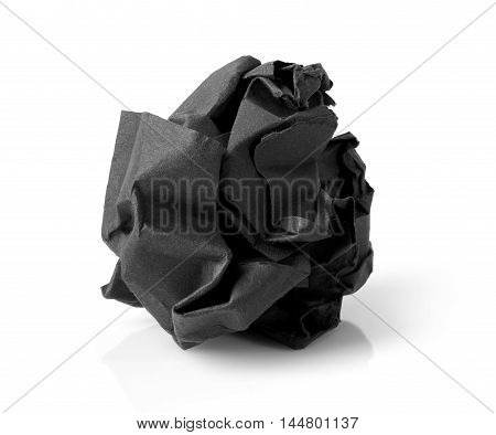 Black wrinkled paper ball isolated on white background symbol of recycling and wasting our resources.
