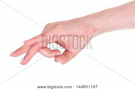 Young female hand shows a gesture isolated over white background