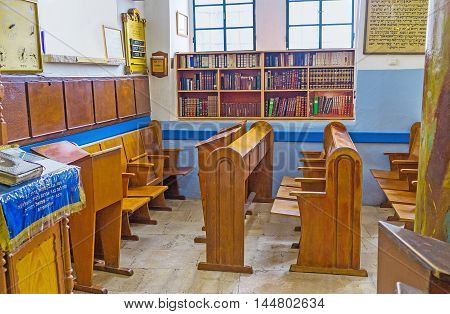 SAFED ISRAEL - FEBRUARY 22 2016: The chairs for Torah readers and the book shelves in Ari Ashkenazi Synagogue on February 22 in Safed.