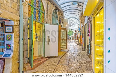 SAFED ISRAEL - FEBRUARY 22 2016: The numerous stalls of Gallery street wait for the tourists and offer different souvenirs on February 22 in Safed.