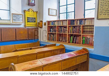 SAFED ISRAEL - FEBRUARY 22 2016: The small library next to the worshipers' benches in Ari Ashkenazi Synagogue on February 22 in Safed.