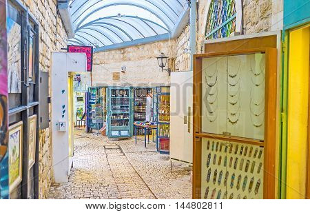 SAFED ISRAEL - FEBRUARY 22 2016: The stalls of Gallery street offers handmade jewelries and wide range of mezuzahs on February 22 in Safed.