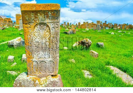 The stone khachkar covered with the carved religious ornaments with many different crosses Noratus Cemetery Gegharkunik Province Armenia.