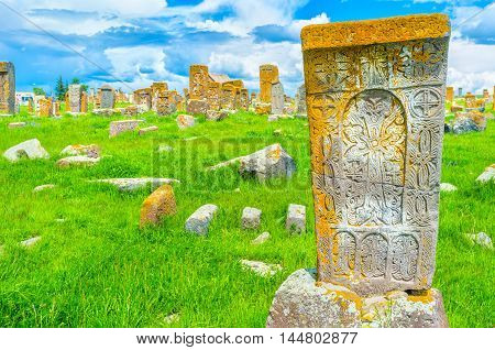 The carved patterns on the old khachkar with the cross crack in the middle of the stone block Noratus Cemetery Gegharkunik Province Armenia.