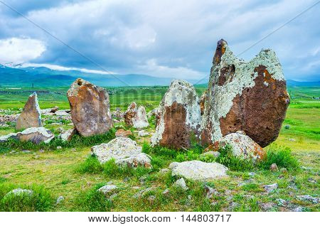The ancient boulders covered with lichen and moss connected into the circles forms archaeological site of Zorats Karer Sisian Syunik Province Armenia.