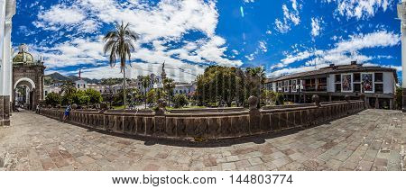 QUITO ECUADOR - JUNE 30 2015: Panoramic view of 180 degrees the Plaza Grande or Independence from the cathedral to the north. Where tourists enjoy a sunny morning.