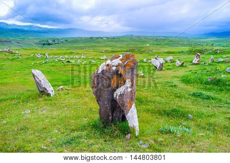 The boulder in Zorats Karer archaeological site covered with different colored lichen Sisian Syunik Province Armenia.