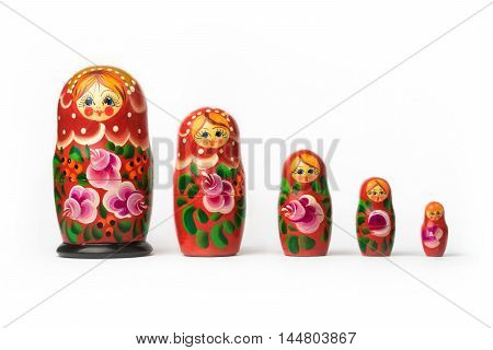 Russian matryoshka each of a set of brightly painted hollow wooden dolls of varying sizes designed to nest inside one another