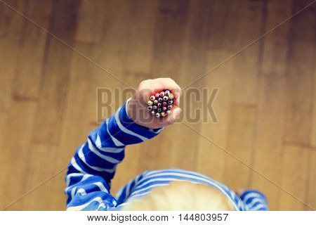 child hand with pencils, education and learning concept