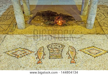 TABGHA ISRAEL - FEBRUARY 22 2016: The mosaic floor of the Multiplication Church depicts the fishes and basket with loaves which Jesus fed five thousand people on February 22 in Tabgha.
