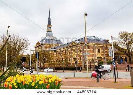 Hague, Netherlands - April 5, 2016: Royal Stables with clock tower and street view in Hague, Netherlands