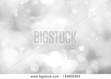 backdrop white bokeh blurred background. abstract background with a white Light silver