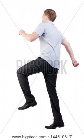 back view of walking  business man. Smiling office worker runs.  going young guy in red shirt. stylishly dressed in formal wear young man. Isolated over white background. Rear view people collection